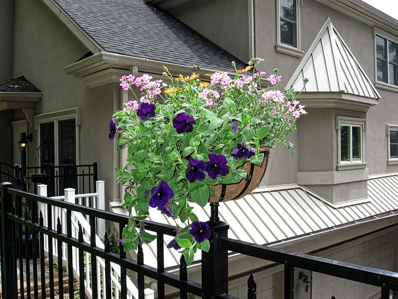 Planter with flowers on Aluminum Fence Post